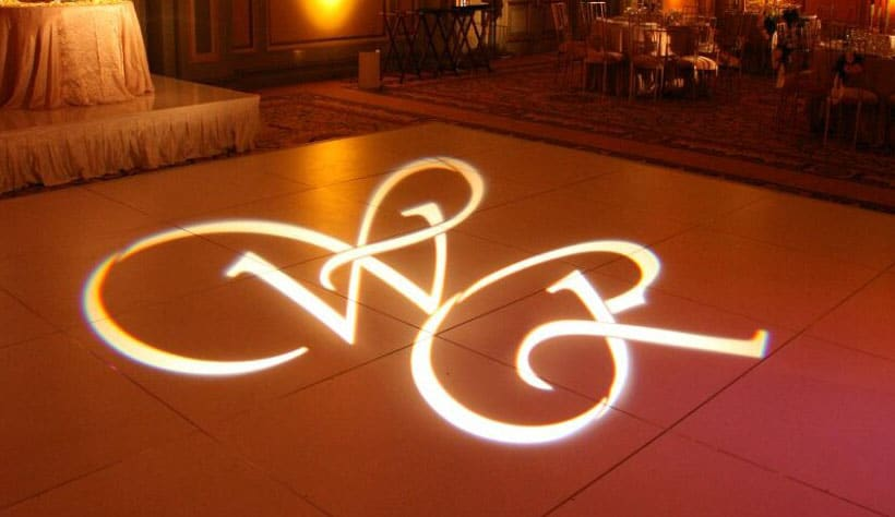 Custom image or text projected on wall or dance floor.